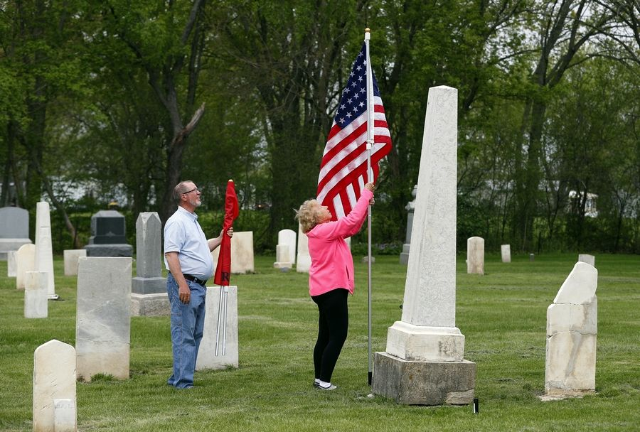 Volo resident and history buff Vern Paddock and his wife Ruth on Friday placed American flags at the grave sites of 45 veterans buried at the Fort Hill Cemetery near Round Lake in tribute for Memorial Day.
