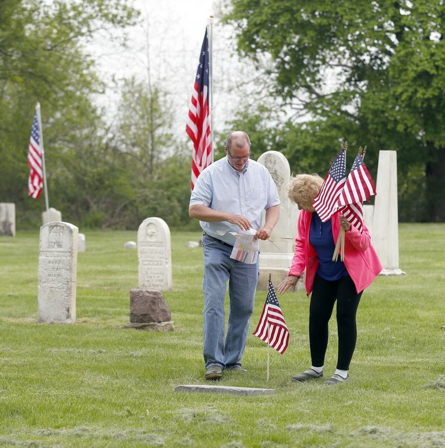 Volo resident and history buff Vern Paddock and his wife Ruth on Friday placed American flags at the grave sites of 45 veterans buried at the Fort Hill Cemetery on Route 120 near Round Lake.
