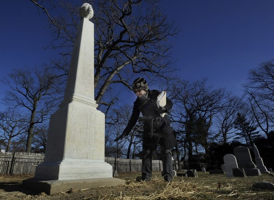 AT DAILYHERALD.COM/VIDEO: Moraine Township Trustee Cindy Wolfson, who is overseeing restoration work at the pioneer-era Daggitt Cemetery along Lake-Cook Road in Highland Park, stands near the monument to the cemetery's founder, Robert Daggitt.