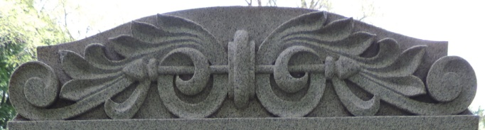 C:\Users\Vern\Pictures\Historical\Fort Hill Cemetery\COMBINED FORT HILL PHOTOS\Fort Hill gravestone symbols\Leaves and arrows - William and Nancy Paddock.JPG