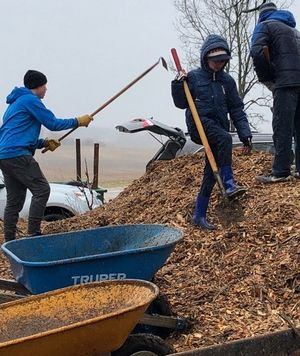 Cold spring temperatures didn't stop workers from spreading mulch at Swan Cemetery.