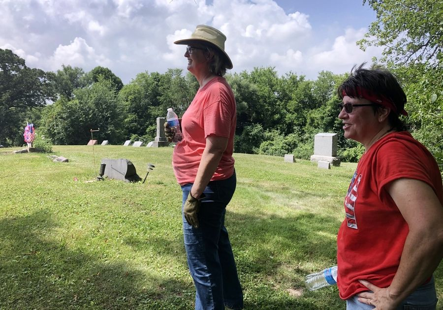 Heide Olson, left, secretary of the Mount Rest Cemetery Association, and Pam Holmes, a Lake Villa resident and member of the Daughters of the American Revolution, are working to preserve and restore the historic Mount Rest Cemetery in northern Lake County.