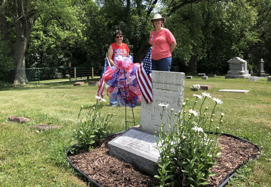 Pam Holmes, left, and Heide Olson visit near the grave of Henry Collins at Mount Rest Cemetery. Collins is one of two Revolutionary War soldiers known to be buried in Lake County.